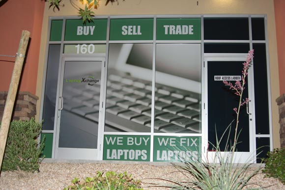 Perforated window graphics for Laptop Exchange in Las Vegas