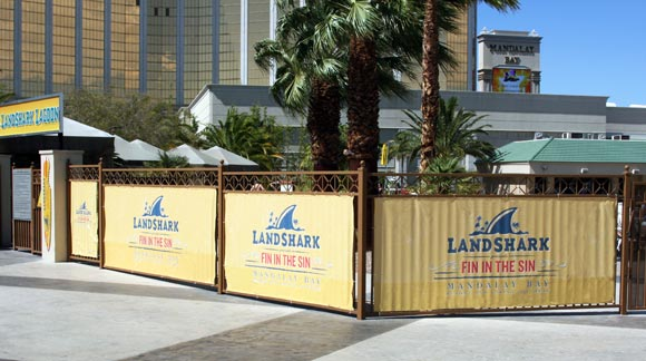 Banners hanging on the Mandalay Bay Pool Fence