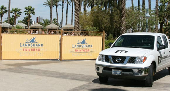 Large Color Landshark Banners installed on Poolside Fence