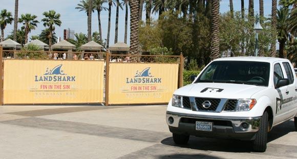Large Color Landshark Banners installed on Poolside Fence